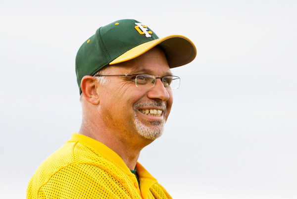 Floyd Central's head baseball coach Casey LaDuke shares a laugh while coaching third base during their game against Seymour last week. Staff photo by Christopher Fryer