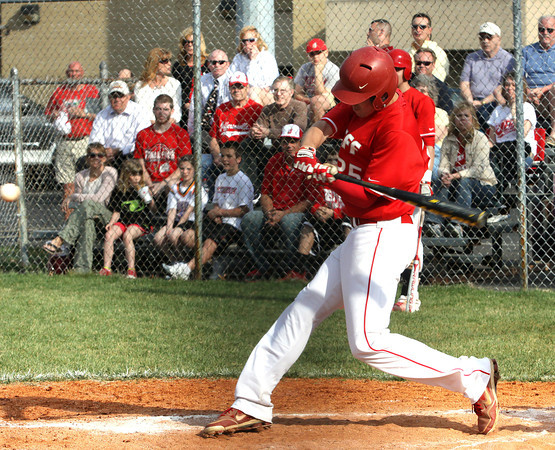 Jeffersonville batter Nick Gallagher belts a triple at Providence Monday afternoon. Staff photo by C.E. Branham