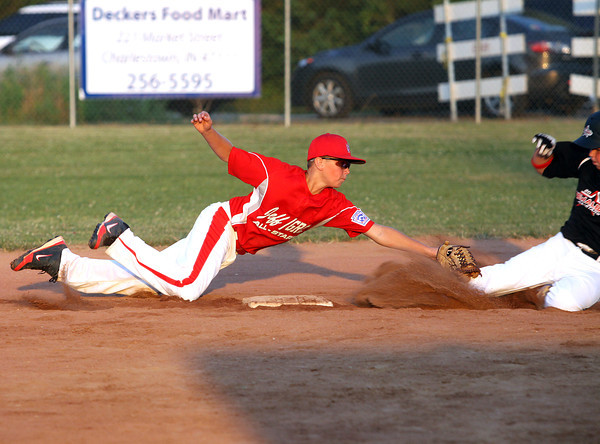 Jeff/GRC 11-12 All-Star Bailey Falkenstein stretches out for an out on New Albany All-Star Reece Davis Friday night. Staff photo by C.E. Branham