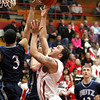 Jeffersonville guard Myles Harvey drives to the basket against Evansville Reitz Friday night. Staff photo by C.E. Branham