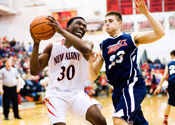 New Albany forward DeAnthony Warren drives to the basket during the Bulldogs' home game against Bedford North Lawrence on Friday. Staff photo by Christopher Fryer