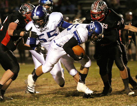 Charlestown running back Seth McCutchen finds a hole to pick up a first down for the Pirates against Brownstown Central Friday night. Staff photo by C.E. Branham