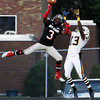 New Albany High School junior Ravon Wright breaks up a pass intended for Castle High School senior Jon-Marc Anderson during the first half of their game at New Albany on Friday evening. Staff photo by Christopher Fryer