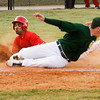 Jeffersonville's Damin Smith slips past Floyd Central's Brandon Smith to steal home during their game at Floyd Central on Wednesday. Floyd Central won the game, 6-5. Staff photo by Christopher Fryer