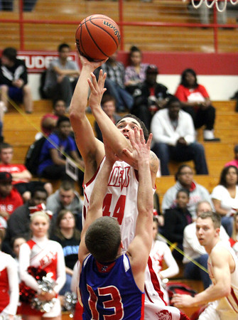 Jeffersonville guard Myles Harvey shoots over the Jennings County defense Thursday night. Staff photo by C.E. Branham