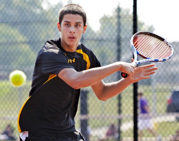 Clarksville High School senior Austin Johnson returns the ball to Austin High School junior Chris Mayfield during their No. 1 singles at New Albany High School on Saturday morning. Johnson won the match in double overtime. Staff photo by Christopher Fryer