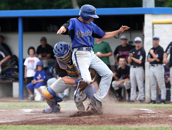 Silver Creek catcher Zach Spaulding tags out Charlestown batter Jordan Hensley-Cole in the 3A sectional championship game at North Harrison. Staff photo by C.E. Branham