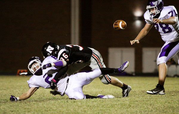 New Albany senior Jesse Demuth breaks up a pass intended for Seymour senior Jackson Stuart during the first half of their game at New Albany on Friday. New Albany lost the game, 22-20. Staff photo by Christopher Fryer