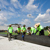 A crew with Sprinturf, based out of Atlanta, works to install field turf at New Albany's Buerk Field on Wednesday morning. The installation is expected to be complete by July 14. The artificial playing surface is also scheduled to be installed at Floyd Central, and should be completed by the end of July. Staff photo by Christopher Fryer