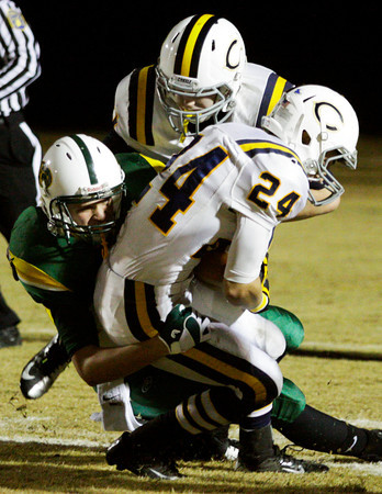 Floyd Central wide receiver Collin Engle brings down Castle cornerback Alex Bush after he intercepted a pass intended for running back Garry Posey during the second quarter of their game in the Class 5A Football Sectional at Floyd Central on Friday. Staff photo by Christopher Fryer
