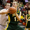 Floyd Central forward Colton Kimm and New Albany forward Jeff Byrne struggle for possession of the ball during their game at New Albany on Friday. Staff photo by Christopher Fryer