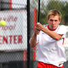 Jeffersonville no. 1 singles player Jordy Rigsby returns volley to Providence player Robert Carrico in the Jeffersonville Tennis Sectional semi-finals. Staff photo by C.E. Branham