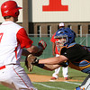 Silver Creek catcher Zach Spaulding tags out Jeffersonville player Trent Astle at home plate Wednesday night at Jeff. Staff photo by C.E. Branham