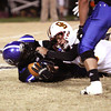 Charlestown defender Desmond Wiley recovers a Gibson Southern fumble in Regional play Friday night. Staff photo by C.E. Branham