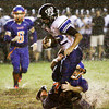 Charlestown junior Cameron Hopson is brought down by Silver Creek junior Kaleb Prince during their game at Silver Creek on Friday. Staff photo by Christopher Fryer