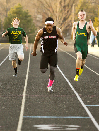 New Albany junior Tuwan Payton competes in the  200-meter dash during their home meet against Floyd Central on Tuesday. Staff photo by Christopher Fryer