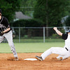 Henryville freshman Cody McAfee makes it safely to second base on a double RBI during their game against Clarksville in the first round of the Providence sectional tournament on Wednesday. Staff photo by Christopher Fryer