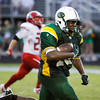 Floyd Central running back Garry Posey drives the ball down field during the first half of their home game against Madison on Friday. Staff photo by Christopher Fryer