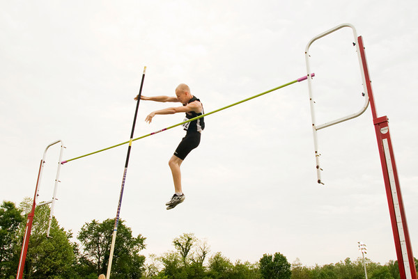 New Albany sophomore Tanis Heath competes in the pole vaulting competition during the Floyd Central sectional track meet on Thursday. Staff photo by Christopher Fryer