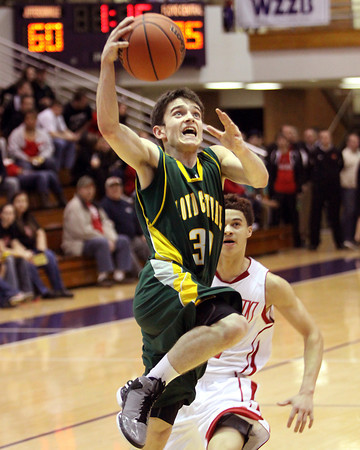 Floyd Central sophomore Aiden Cora drives to the basket against Jeffersonville in 4A sectional play Tuesday night. Staff photo by C.E. Branham