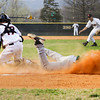 Floyd Central's Trey Fulton slides safely across home plate for their sixth run during their game at New Albany on Wednesday. Staff photo by Christopher Fryer