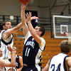 2007 Providence player Luke Fitzgerald puts a shot up in a benefit game Thursday between the 2007 and 2012 Providence Regional championship teams. Staff photo by C.E. Branham