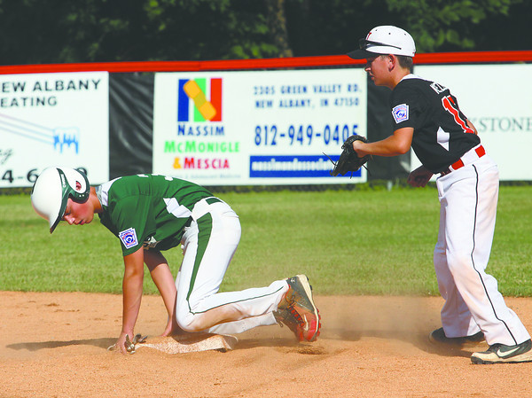 HYR 11-12 player Joe Wilkinson steals second base in a District V pool play game against New Albany on Saturday. Staff photo by C.E. branham