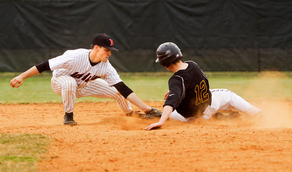 New Albany's Tucker Marcum tags out an Avon runner during their game in New Albany on Thursday. Avon won the game, 9-3. Staff photo by Christopher Fryer