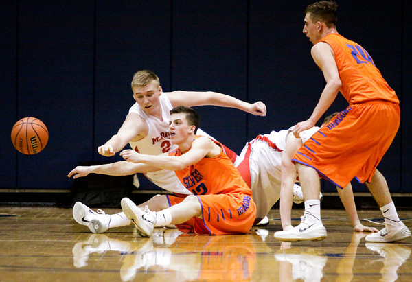 Silver Creek guard Brooks Howell passes our of pressure after gaining possession of a loose ball during the Dragons' game against Madison at the North Harrison Sectional on Wednesday. Staff photo by Christopher Fryer