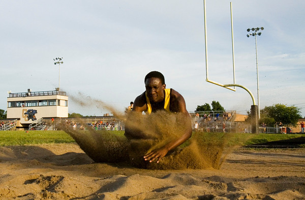 Clarksville senior Marquise Parrish hits the sand during the long jump competition at the Corydon Sectional on Thursday. Staff photo by Christopher Fryer