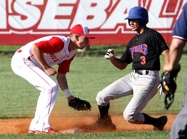 Silver Creek batter Jamie Valvano reaches second for a double ahead of Jeffersonville shortstop Drew Ellis at Jeff on Wednesday. Staff photo by C.E. Branham