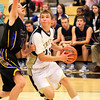 Henryville senior Tyler Collins scores from the baseline against Christian Academy on Tuesday night. Staff photo by C.E. Branham