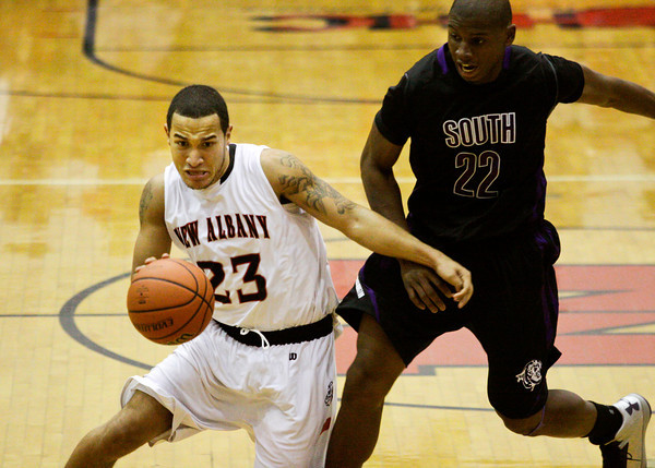 New Albany guard Jermaine Parrish drives past Bloomington South guard Jonathon Winters during the second half of their game in New Albany on Saturday. New Albany won the game, 61-57. Staff photo by Christopher Fryer