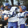 Charlestown wide receiver Cody Donahue celebrates a 15 yard touchdown reception with fellow Pirate Gage Brafford Friday night at Clarksville. Staff photo by C.E. Branham