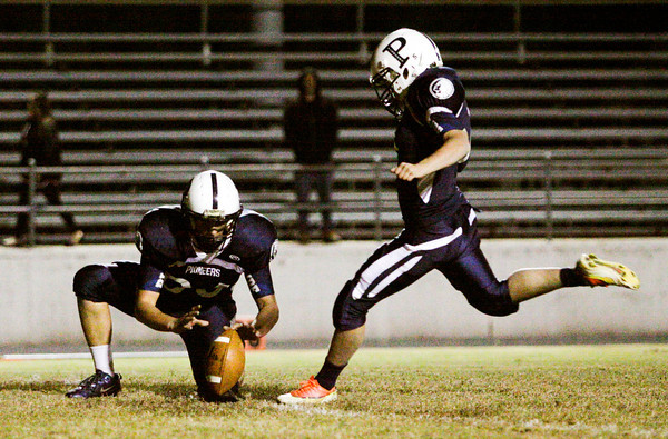 Providence kicker Mason Koetter kicks an extra point during their Class 2A Sectional game at home against Emmerich Manual on Friday. Staff photo by Christopher Fryer
