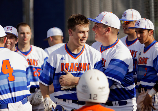 Silver Creek senior Brayden Ware is congratulated by his teammates after hitting an inside-the-park home run during the Dragons' 14-0 win over Clarksville in Sellersburg on Thursday. Staff photo by Christopher Fryer