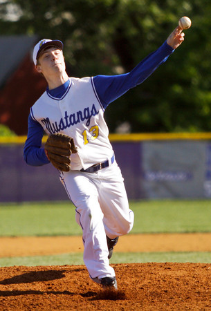 New Washington sophomore Lane Johnson pitches during their game against Borden in the Lanesville sectional tournament on Friday. Staff photo by Christopher Fryer