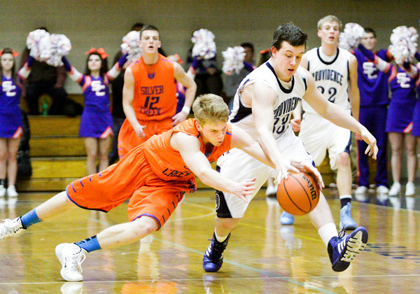 Providence senior Brad Koerner and Silver Creek junior Nick Tinsley scramble for a loose ball during their game at Providence on Tuesday. Staff photo by Christopher Fryer
