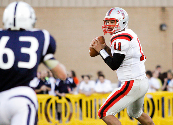 Jeffersonville quarterback Chris Campbell looks to pass during their game at Providence on Friday. Staff photo by Christopher Fryer