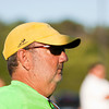 Floyd Central coach Rick Miller watches his players during their home match against Madison on Monday. The Highlanders' victory over Madison made Miller the winningest high school boys tennis coach in Indiana. Staff photo by Christopher Fryer