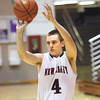 New Albany sophomore Jeffery Byrne hit three consecutive three point shots to open the Bulldogs' 4A sectional game against Seymour. Staff photo by C.E. Branham