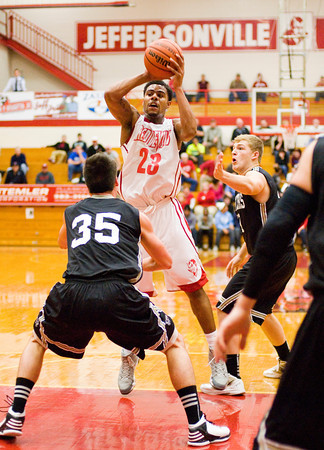 Jefferonville's Darryl Baker moves to pass out of pressure during their home game against Corydon Central on Tuesday. Staff photo by Christopher Fryer