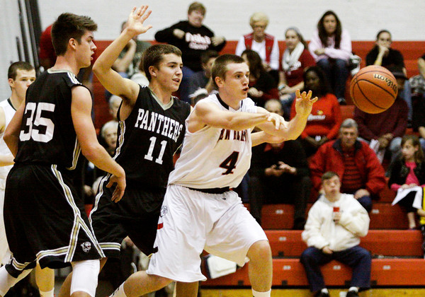 New Albany forward Jeff Byrne passes the ball away from pressure during their home game against Corydon Central on Saturday. New Albany won the game, 63-48. Staff photo by Christopher Fryer