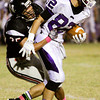 New Albany junior Devin Higgins takes down Seymour senior Gabe Jordan during the second half of their game at New Albany on Friday. New Albany lost the game, 22-20. Staff photo by Christopher Fryer