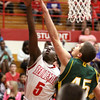 Jeffersonville guard Jacquari Chandler gets to the rim against Floyd Central Friday night. Staf photo by C.E. Branham