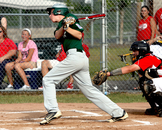HYR 13-14 All-Star Chase Smith rips a two-run double against Jeff/GRC in pool play of the District V tourney Friday night. Staff photo by C.E. Branham