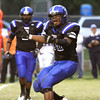 Charlestown defensive lineman Desmond Wiley lets out a yell after sacking Providence quarterback Nathan Banet Friday night at Charlestown. Staff photo by C.E. Branham