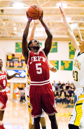Jeffersonville senior Leonard Kwitonda goes up for a shot during the Red Devils' game at Floyd Central on Friday. Floyd Central won the game, 71-70. Staff photo by Christopher Fryer