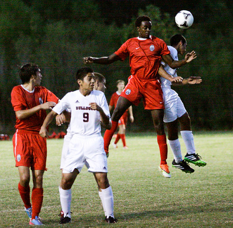 Jeffersonville senior Leonard Kwitonda and New Albany senior Bryan Kong fight for possession of a Jeffersonville corner kick during their game at New Albany on Tuesday. Jeffersonville won the game, 2-1. Staff photo by Christopher Fryer