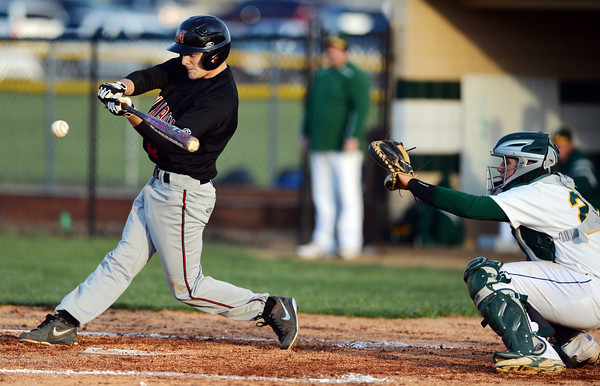 New Albany second baseman Tucker Marcum connects with a pitch during Floyd Centrals' 12-4 victory over the Bulldogs Wednesday evening.<br /> Staff photo by Tyler Stewart